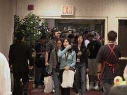 Anxious shoppers rush to enter the dealers' room