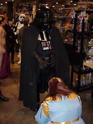 The Delvian kneels before Lord Vader