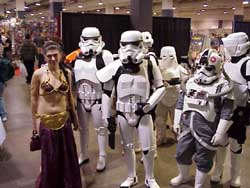 Princess Leia being escorted away from fanboys by stormtroopers